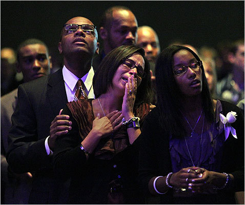 Henry's father held Angella during the service.