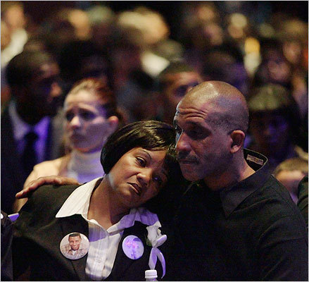 Kim Henry, an aunt of Henry was comforted during the memorial.