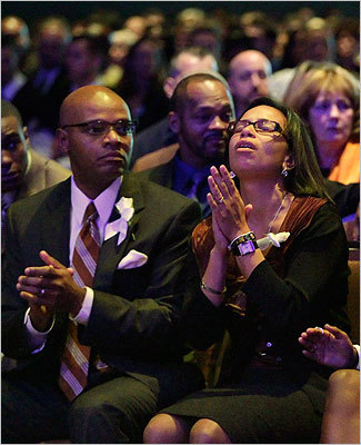 Angella Henry, mother of Danroy 'D.J.' Henry, Jr. held her hands as she sat with her husband and Danroy's father Danroy Henry Sr., during a memorial service at the Boston Convention & Exhibition Center on Oct. 29, 2010. Henry, an Easton native and Pace University football player, was shot by police outside a New York bar on Oct. 17, 2010.