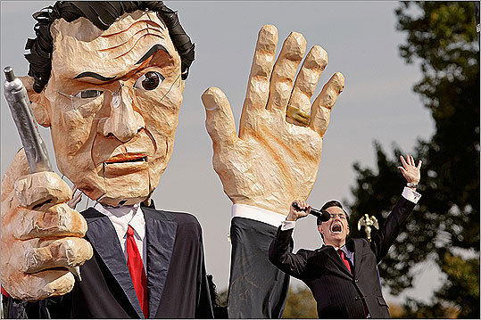 Colbert led a cheer in front of a giant paper mache puppet of himself.