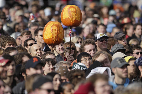 People carried pumpkins with the likeness of Stewart and Colbert.