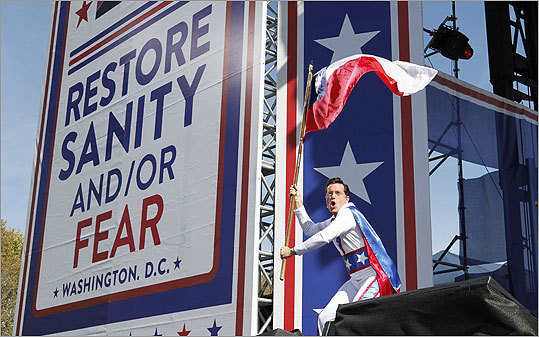 Colbert stormed the stage waving a flag.