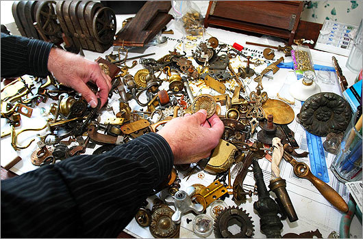 Bruce Rosenbaum shows off a collection of various items he uses to make his pieces.