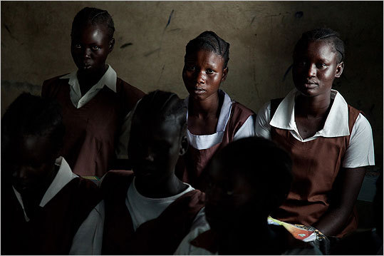 Young girls waited for their teacher to show up to class in Malakal. Many times teachers don't show up because they are paid very little. The students sit and study in class anyway.