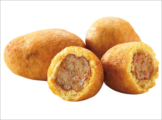 Dunkin' Sausage Pancake Bites Portable pigs in a blanket? Mini corn dogs? Whatever they are, they're unique. Dunkin' Donuts unveiled the newest addition to its menu recently. A package of three bite-sized sausage links wrapped in a maple flavored pancake sell for $1.59. Are you chomping at the bit for pancake bites? Market Research