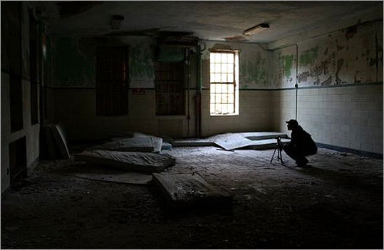 Jason Baker likes taking pictures of abandoned buildings, both inside and out. His passion for documenting decaying places has drawn him into the darkened corridors of insane asylums, hospital wards, shuttered schools and other deserted institutions all over New England. Read the story . Baker set up a shot during one of his shoots.