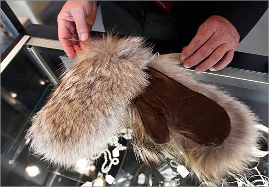 These fur mittens once belonged to Bernie Madoff's wife, Ruth.