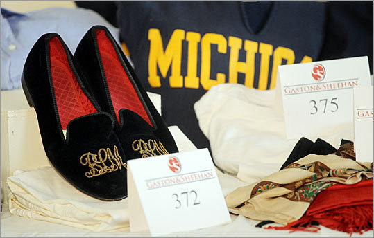 A pair of 'BLM' embroidered velveteen slippers were displayed among other items - such as a Michigan shirt - at a press preview before the auction.