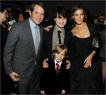At the premiere after party at Lincoln Square on Nov. 15, Matthew Broderick (left), his wife Sarah Jessica Parker, and their 8-year-old son, James Wilkie Broderick, posed with Daniel Radcliffe (center).