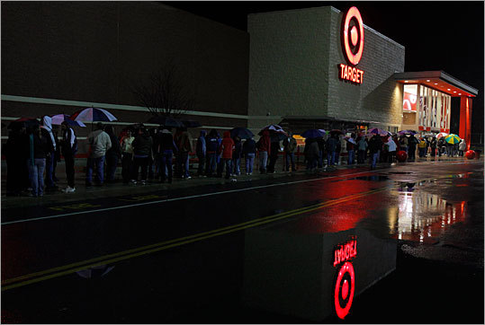Black Friday shoppers waited for a Target store to open in Lanesborough early this morning. As the holiday shopping season kicked off amid light rain and cold temperatures, shoppers searched for deals on high-definition televisions and popular toys early, and retailers hoped that 'Black Friday' would kick off the best holiday shopping season in three years. Check out scenes from across the state.