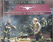 Photos: Fire strikes DeLuca's Market