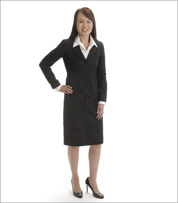Women What to wear This dark, neutral-colored suit creates a professional, classic look that would likely work in a conservative field, like banking or legal. A skirt-suit is often considered a standard interview outfit, so opt for it in a traditional environment. There is nothing distracting about this look, as her hair is neat and she is wearing minimal jewelry.