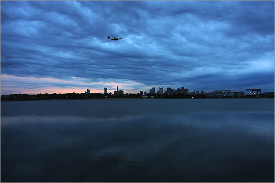 It's a bird, it's a plane . . . wait, it is a plane! Sheng Lin of Malden submitted this photo of the Boston skyline taken from Castle Island.