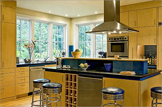 Ways of seeing : The lower kitchen height allowed the homeowners to add plenty of ceiling lights and to vent the stove. The cave-like 1950s kitchen at the back of the house was scrapped.