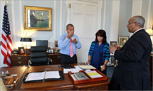 Chief of Staff Arthur Bernard (far right) conferred with Governor Deval Patrick and executive assistant Michele Mansilla two days after Patrick was re-elected. Patrick announced today Bernard will be leaving his position.