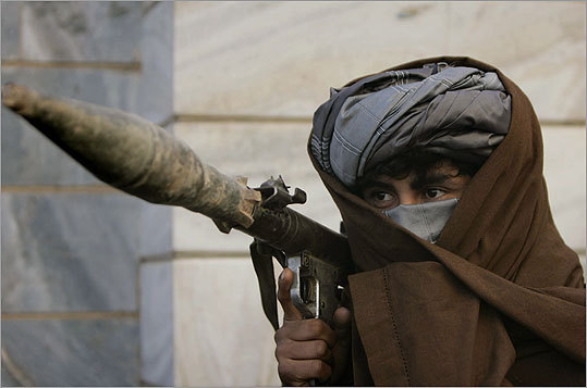 A former Taliban fighter carried a rocket launcher before surrendering it to Afghan authorities in Herat, west of Afghanistan.