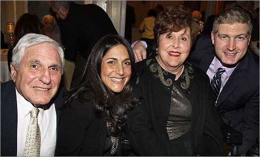 Dec. 9 in Boston Honored guest Wendy Semonian Eppich (second from left) with her father, Leon Semonian of Newton (left), her mother, Marion Semonian, Improper Bostonian publisher, and Wendy's husband, Bill Eppich of Charlestown.
