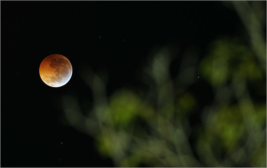 Because of recent volcanic activity that left ash in the atmosphere, scientists had predicted the moon would appear red or brown during the full eclipse. The eclipse could be seen from The Americas Square in San Salvador.