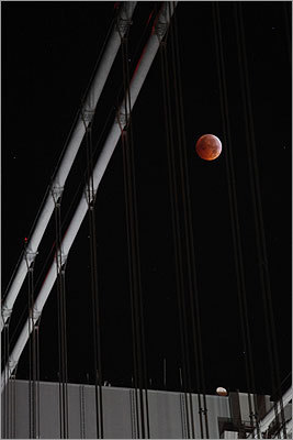 The moon was seen through supports for the Verrazano-Narrows Bridge between Brooklyn and Staten Island in New York.