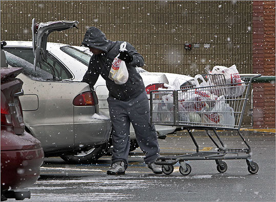 A shopper loaded groceries into his trunk after leaving a Market Basket store.