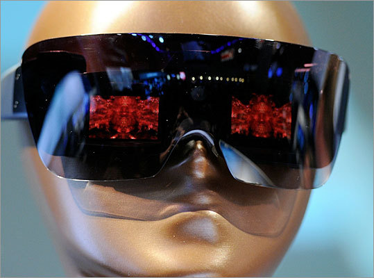 Lady Gaga-approved camera eyewear Last year, Polaroid announced their partnership with Lady Gaga to create a new line of products, the Polaroid Grey Label. This year, they unveiled the Polaroid GL20 Camera Glasses. These glasses include a built-in camera with dual LCD screens that cover your eyes. The Gag/Polaroid partnership also unveiled an instant digital camera and an instant printer. No word yet on the prices for these devices.