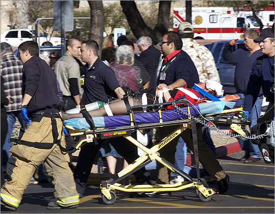 Emergency personnel moved Giffords after she was shot in the head.