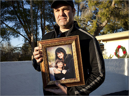 Greg Segalini held a photo of his niece Christina Green and his sister, Roxanna Green. Christina, 9, was victim of the shooting spree by Jared Loughner Saturday.