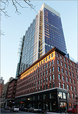This 31-story glass-walled tower is at the corner of Congress Street and Atlantic Avenue in Boston's Fort Point Channel district. The tower is part of a complex that fills a large gap in the city's effort to transform the area into a modern waterfront with new residences, restaurants, boating tours, and cultural intitutions.