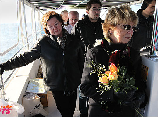 A small gathering of mourners recently joined together to pay their respects to a deceased loved one by scattering her ashes in Boston Harbor. This type of service has been a growing trend recently. The service for Nancy Mastrangelo left from Rowes Wharf in Boston on board the 'Beach Cat,' a water taxi captained by Captain Brad White. The boat drove them out into the harbor where they scattered Nancy's ashes. Left to right: Christine Whelan, her son Michael Mastrangelo, and sister of the deceased Elinore Loscocco.