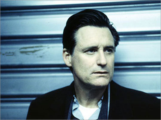 Rick Rick (Bill Pullman) talks down to people, believes he is superior, and strives for power in the corporate world