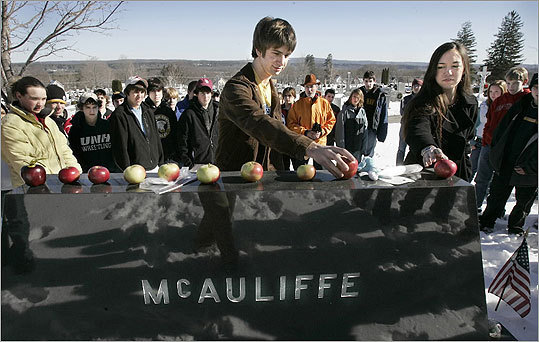 In this 2006 photo, students from Concord High school visited McAuliffe's grave at Calvary cemetery.