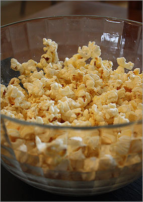 Garlic-parmesan popcorn Yield: 20 cups Ingredients 3 tablespoons unsalted butter 2 cloves garlic, minced 2 tablespoons vegetable oil 1 cup unpopped popcorn 1/2 cup finely grated Parmesan 1/2 teaspoon cayenne pepper Salt Full recipe