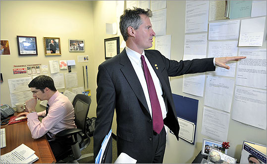 US Senator Scott Brown plans to link the book tour for his memoir with his re-election campaign tour. Brown looked at thank-you notes in his office Jan. 11.