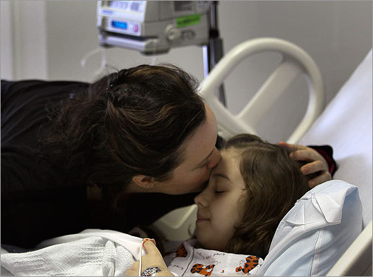 Patient Azaria Adipietro, 10, got a kiss from her mother, Jeannine Adipietro, of Framingham.