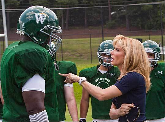 Quinton Aaron as Michael Oher and Sandra Bullock as Leigh Anne Tuohy