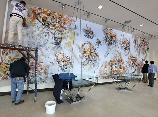 The 51-by-11-foot mural 'Signals' is installed in the Philip Alden Russell (1914) East Gallery. The work, by C.E.B. Reas and Ben Fry from the Lab of Michael Yaffe, shows a network of signals in a cancer cell.