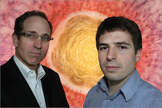 Robert Urban, left, is executive director of the institute and Alex Fiorentino is the exhibition developer. They stand in front of 'Sunrise In The Eye: The Making Of A Retina' by Kara Cerveny, Steve Wilson Group, University College London.