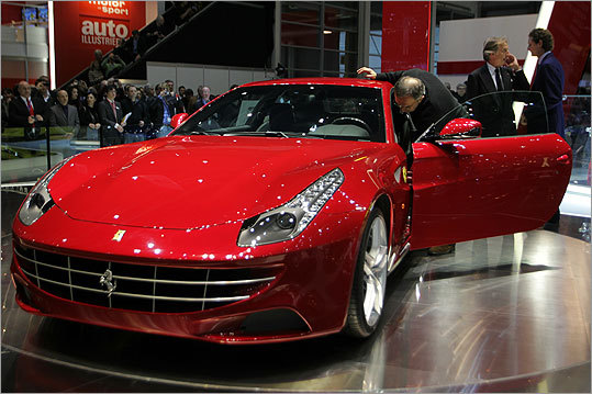 Chrysler and Fiat CEO Sergio Marchionne, left, checked out the new Ferrari FF, the Italian maker's first all-wheel-drive sports car. The FF stands for 'For Four,' but instead of building a sedan or large coupe like the outgoing 612 Scaglietti, Ferrari chose a 'shooting brake' hatchback design.