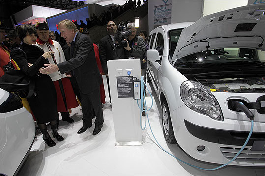 Micheline Calmy-Rey, left, the Swiss president and foreign minister, listened to Arnaud de Kertanguy, managing director of Renault Switzerland, in front of a Kangoo Z.E. electric car.