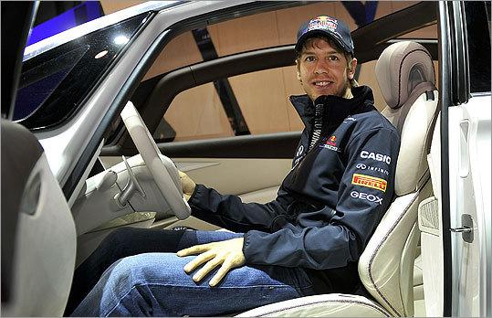 Germany's Formula One 2010 world champion Sebastian Vettel posed at Infiniti's booth.