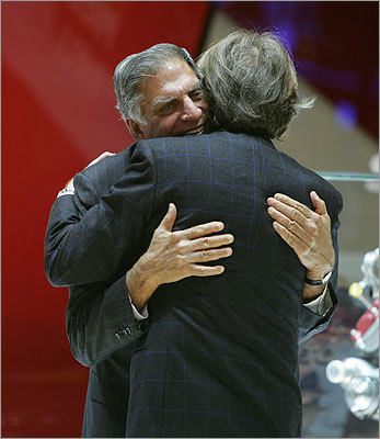 Ferrari President Luca Cordero di Montezemolo, right, hugged Ratan Tata, president of Tata sons, at the Ferrari booth.