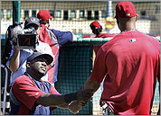 David Ortiz (left) talked with Cardinals slugger Albert Pujols