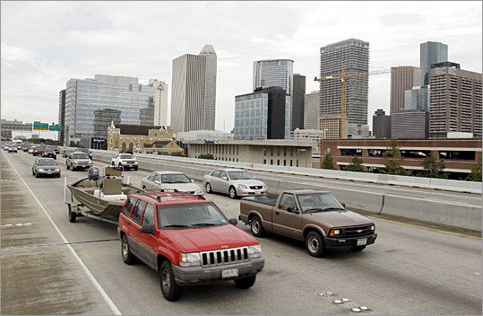 7. Houston Average commute during worst driving hours: 33 percent longer on Friday at 5:15 p.m. This other Texas city isn't as congested as Dallas, but it makes the cut due to trips like the commute on US-59 between Buffalo Speedway and I-45. This 4.8-mile stretch or road, which usually takes five minutes to complete with no traffic, can take up to 14 minutes during rush hour and 24 minutes on Friday afternoon. Pictured: People returned to the Houston area after the threat of Hurricane Rita passed in 2005.