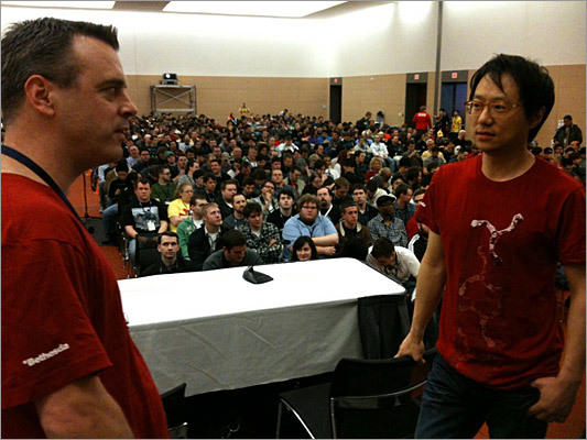 Id Software senior producer Jason Kim (right) and design director Matt Cooper during a live demonstration of RAGE, a new first-person shooter set in a ruined, Road Warrior-like post-apocalyptic world of guns, mutants, and survivors. 'You try to rebuild society but nothing goes according to plan,' said Cooper. During the demo, the sold out crowd cheered every time a bad guy in the game got his head blown apart.