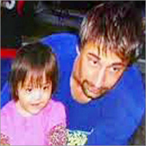 A 2008 Wiens family photo provided by Brigham and Women's Hospital, shows Dallas Wiens with his daughter, Scarlette, prior to the electrical accident that disfigured his face.