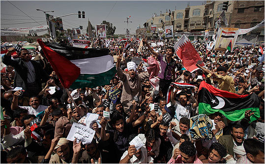 Anti-government protesters shouted slogans and waved the Libyan, Bahraini and Palestinian flags during a demonstration demanding the resignation of Yemeni President Ali Abdullah Saleh, in Sanaa,Yemen.