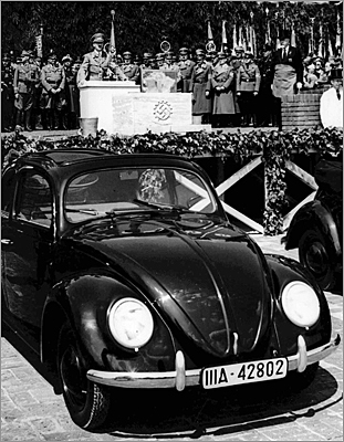 The Volkswagen Beetle, which was called KdF-Wagen at the time of launch, was designed with the average family in mind, with enough room to carry five people. Pictured here is Hitler speaking at the grand opening of the Volkswagen car factory in Fallersleben, Germany, in 1938.