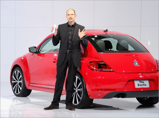 On April 18, Volkswagen announced the new design, which gets rid of many of the adorable curves in favor of a flatter, edgier look that is expected to attract a more male demographic. The company went back to a more vintage look, taking advice from the original Beetle's design. 'It ties in more with our other products. It's more upscale,' said Andres Valbuena, VW's lead Beetle project manager for the United States. It goes on sale this fall. Pictured: Klaus Bischoff, head of design of Volkswagen brand, with the all-new Beetle.
