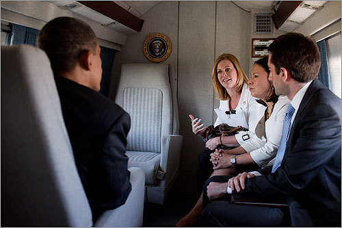 Stephanie Cutter (center), who grew up in Raynham and graduated from Smith College, now serves as one of President Obama's top advisers. Her principal task is helping spread the White House message through an array of communications channels. In June, she spoke with the president aboard Marine One.