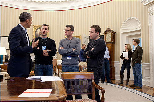 President Obama discussed an upcoming speech to the US Chamber of Commerce in February with staff members. Among them was (second from left) Director of Speechwriting Jon Favreau, who grew up in North Reading and graduated from Holy Cross.